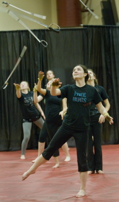 High School senior Nina Goodey, winter guard team captain, practices a saber routine, one of three components in the performance for national competition.