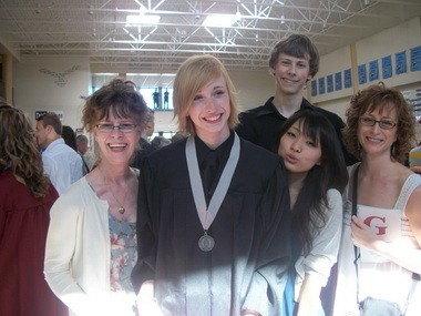 Nick Edwards and his family at his graduation ceremony from Glencoe High in 2010.