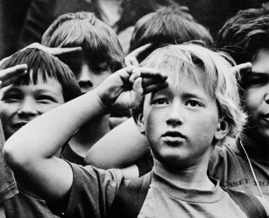 In 1983, a young boy joins his peers in salute at Cub Scout Day Camp, a week packed with outdoor activities on a 12-acre site two miles north of Hillsboro.