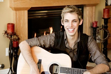 """Derik Nelson, 25, is the lead guitarist on the FOX Network TV show """"Glee."""" Desiring to help other students pursue their dreams in the music industry, Nelson stated the Take Chances Tour, a fundraising concert series for art programs 30 schools across the West Coast, including Hillsboro's Century High School."""