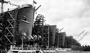 The Kaiser Shipyards in Portland were the most prolific in the United States during World War II and many of the workers lived in Vanport. Some of the ships they turned out are seen in this photo. From left, they are The Dominican Victory, the South, Yugoslavia Victory, Plymouth Victory, Niantic Victory, Rock Island Victory, Claremont Victory and Rutland Victory.