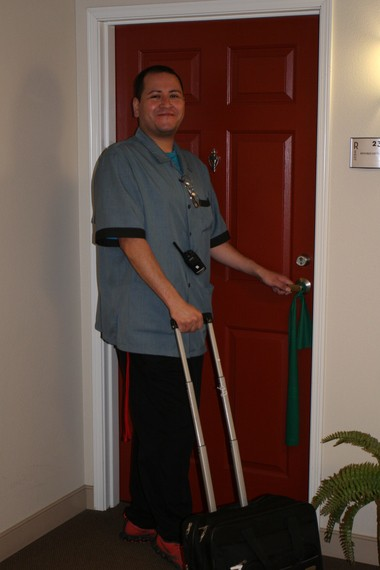 Medaide/Caregiver Ivan Contreras makes daily rounds delivering medications to residents.