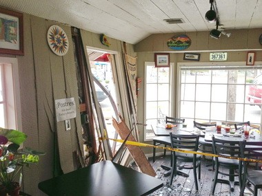 An SUV crashed through the wall of a Lake Oswego restaurant Tuesday, but caused only minor injuries to one customer.