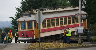 Workers move a vintage Portland Council Crest trolley car off a flat-bed trailer onto tracks next to State Street near E Avenue in Lake Oswego on Tuesday morning.