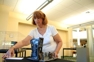 "Hillsboro artist D.K. Lubarsky sets up a display of her Holocaust sculptures at Pacific University. Twelve sculptures from Lubarsky's ""Holocaust Images"" collection will be on display at the university through the end of October. (Kelsey O'Halloran/Forest Grove Leader)"
