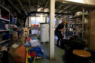 Santen gets started in Ballard's basement by moving an old water heater.