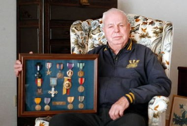 Among the medals awarded Rex Barber of Oregon for his actions in World War II were the Navy Cross (top row, far left), two Silver Stars, the Purple Heart and the Air Medal.