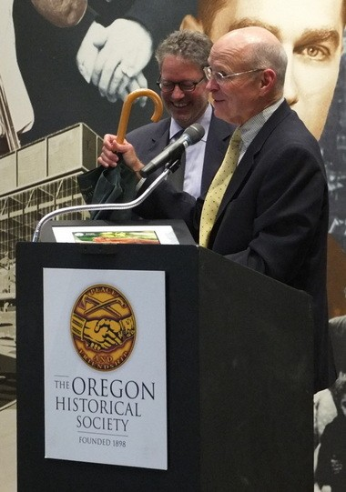 Marc Freedman, left, and Ward Greene, who presented Freedman with an umbrella as a souvenir of Portland.