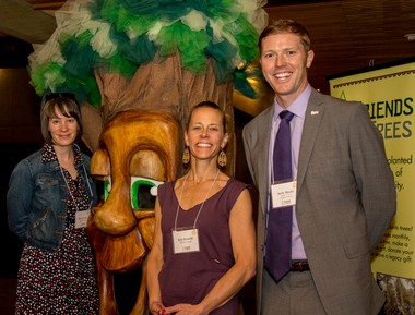 (Left to right) Mary Crowe and Erin Rosvold, both of Whole Foods Market, and Andy Meeks, Friends of Trees development manager, pose with Friends of Trees' mascot Garry Oak.
