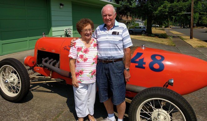 Tom and Lynn Elliott in front of a 1921 Model T Ford race car.