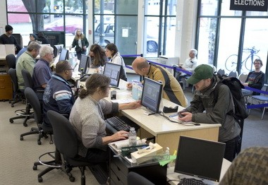 On the Saturday before last November's election, Multnomah County elections workers handle a steady flow of people coming into the office with a variety of ballot-related problems.