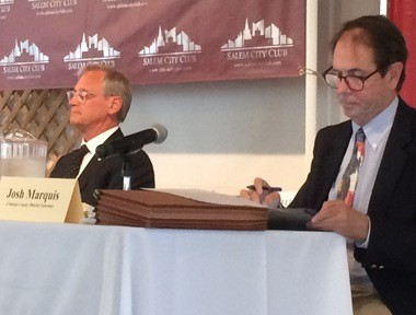 Rep. Earl Blumenauer, D-Oregon, left, and Clatsop County District Attorney Josh Marquis listen to opening remarks by the moderator before their debate Friday at the Salem City Club.