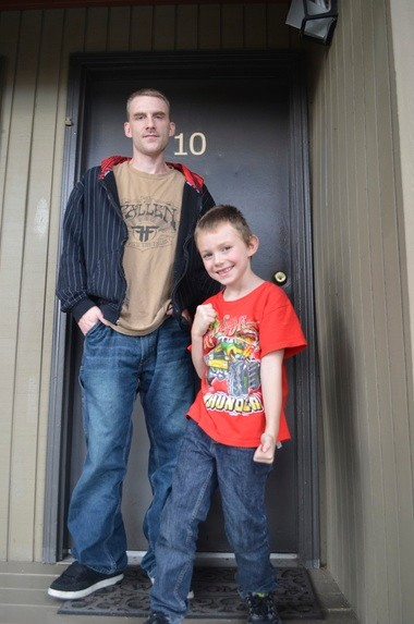 Josh, 28, and Matthew Autry, 7, stand outside the Milwaukie apartment Northwest Housing Alternative's HomeBase program helped them secure. The Autrys were facing homelessness before the nonprofit enrolled them in the program.