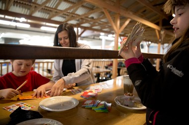 PORTLAND, OREGON - February 10, 2014 - After downing a burger and fries served up by her dad at The Lumberyard, Claire Heiberg, 9, right, counts her finished valentines. Her mom meanwhile helps brother Wyatt, 5, address and seal his. Photo by Faith Cathcart/The Oregonian