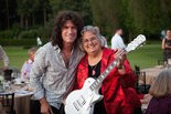 Pacific University president Lesley Hallick (right) with KISS guitarist and university trustee Tommy Thayer, the host of Pacific University Legends held June 26 in Portland. Thayer has hosted the fundraiser since 2007, and this year's event raised nearly $500,000 to launch an endowment in his name to benefit the university's athletics and music programs.
