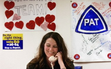 Parents and teachers often work together in Portland. This 2004 photo shows parent Amy Platt at the headquarters of the Portland Association of Teachers, making phone calls to fight the repeal of the Multnomah County income tax.