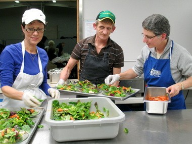 Sue Epps (left),Royal Ediger and Linda McBrearty prepare salad for a Tuesday night dinner at The Jesus Table at Cedar Mill Bible Church.