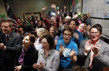 Supporters of Washington's Referendum 74, which upheld the state's same-sex marriage law, cheer at a news conference in Seattle on Nov. 7, 2012. Oregonians might have a chance to follow Washington's lead in November 2014.