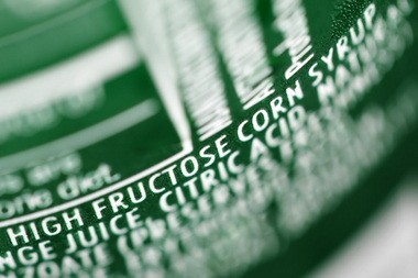 The words high fructose corn syrup, seen here as a primary ingredient on a soda pop bottle, have become a familiar sight. The role of high fructose corn syrup in obesity is under investigation.