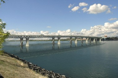 The bridge as designed would expand traffic volumes and also feature a light rail line between Portland and Vancouver.