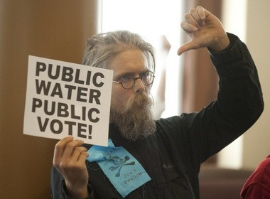 A protester who would not identify himself reacts to a city council vote last year in favor of fluoridating Portland's water supply.