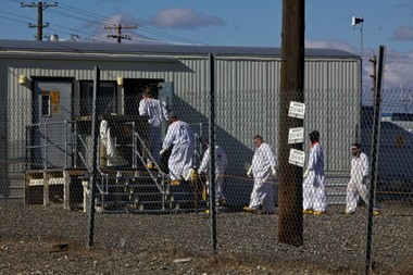 Workers file into a building at Hanford's C tank farm, where radioactive liquids are stored, during a February visit by Oregon Sen. Ron Wyden.