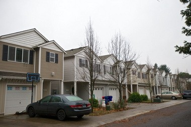 High density housing with few pedestrian amenitites occupies a lot along Southeast 136th Avenue in Portland, creating a car-centric neighborhood.
