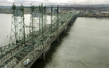 The I-5 bridge over the Columbia River, viewed from Washington and looking south, to Oregon, would be replaced by a higher-capacity modern structure featuring light rail, connecting Portland and Vancouver. But the Oregon Legislature now faces the tough question of whether it can lead the project without immediate funding from Washington.