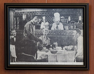 A photocopy of a picture that ran in a hotel-chain magazine features Ancer Haggerty, then a high-school graduate working as a busboy, serving coffee at Portland's London Grill restaurant.