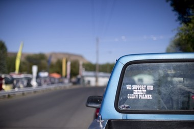 Stickers supporting Sheriff Glenn Palmer outside the Grant County Fair in John Day on August 12, 2016.