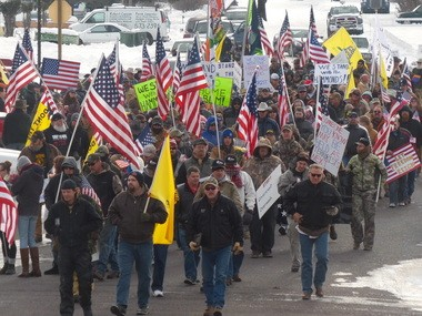 Protesters march along Court Avenue in Burns on Saturday, Jan. 2, 2016, to show their support for the Hammond family.