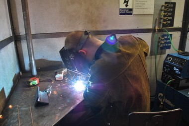 A student participates in the welding competition at last year's event at Clackamas Community College.