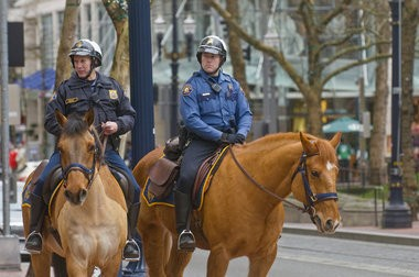 Among the programs on the chopping block: Portland's mounted patrol unit. But Mayor Charlie Hales said the Police Bureau will reshuffle money from other positions to keep four officer positions.