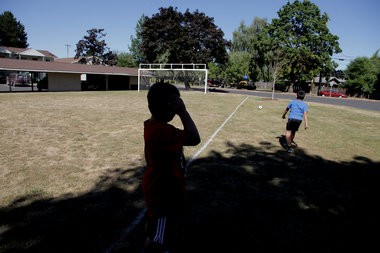 Bryan Hernandez-Pulido, 7, darts away with the soccer ball at the Tamarack soccer field in the North Portland public housing complex.