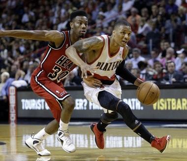 After going 1-for-16 from the field at Orlando on Sunday, Trail Blazers rookie Damian Lillard went 10-for-18 and finished with 33 points on Tuesday in a 117-104 loss at Miami.