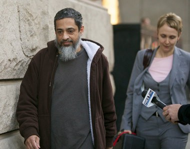 Reaz Khan, a Portland city employee charged with conspiracy to provide material support to terrorists, leaves the federal courthouse after being released from custody pending trial.