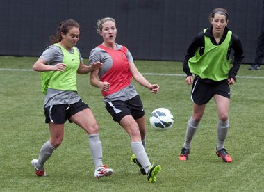 Portland forward Danielle Foxhoven (right, along with Meleana Shin (left) and Becky Edwards) works out during a Thorns training session. The former University of Portland star finished her college career with 57 goals, fourth on the school's all-time list. Brent Wojahn/The Oregonian