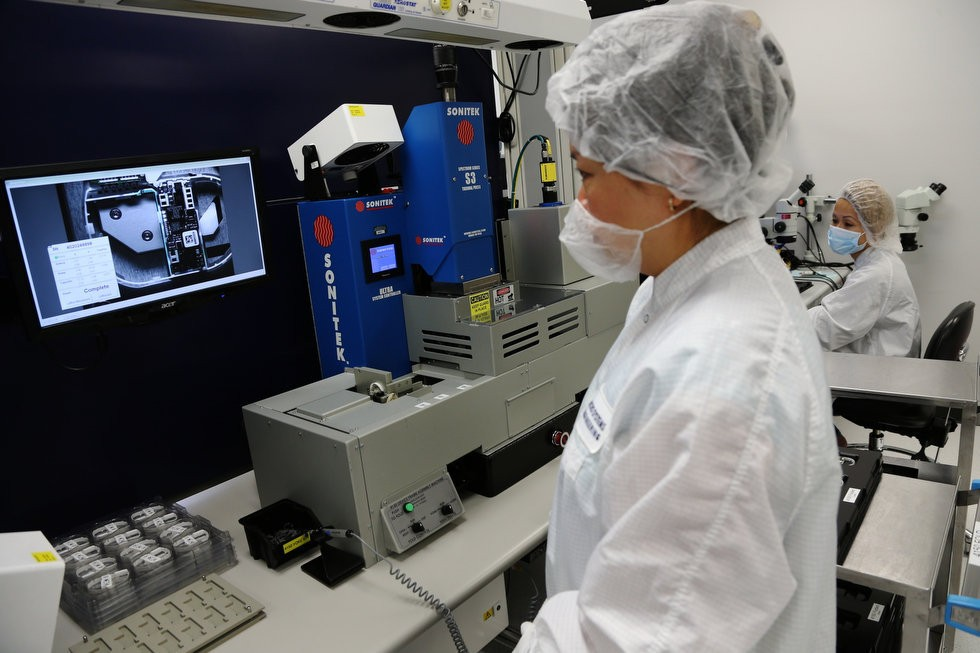 Biotronik Inc, a German medical device company with a factory in Lake Oswego, is under Oregon Department of Justice scrutiny over payments to doctors. Here, a worker makes final inspection of a new and smaller implantable defibrillator.