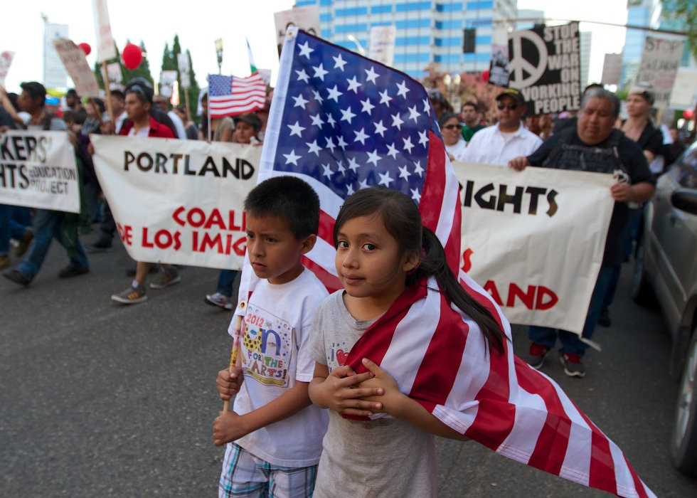 Miguel (left), 9, and Maria Zagal, 10, march at the head of the annual May Day parade that wound through downtown Portland Wednesday afternoon.