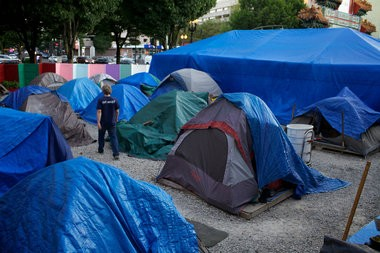 PORTLAND, OREGON - JULY 23, 2013 - Right 2 Dream Too, located at 4th and Burnside, is made up of of 21 smaller tents for members and then some very big tents for the day to day people who sleep overnight. Commissioner Amanda Fritz announced an agreement Monday to move the Right 2 Dream Too homeless camp under the Broadway Bridge for a one-year trial.