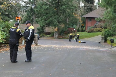 Beaverton police officer were surveying a neighborhood for evidence Nov. 15 where Dave Dahl, co-founder of Dave's Killer Bread, allegedly rammed Washington County sheriff's patrol cars and injured three deputies during a chase the day before. Dahl, 50, of Milwaukie, now faces criminal charges.