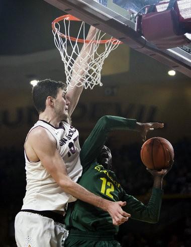 Arizona State center Jordan Bachynski blocks a shot by Oregon guard Jason Calliste on Feb. 8 in Tempe, Ariz.