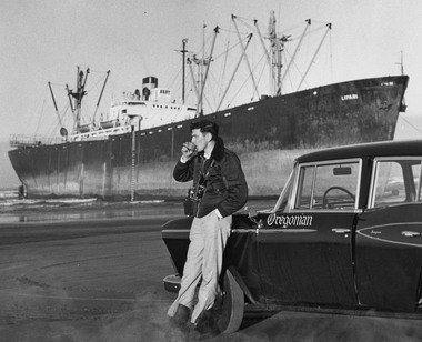 The Oregonian's David Falconer takes a break while covering a ship that ran aground.