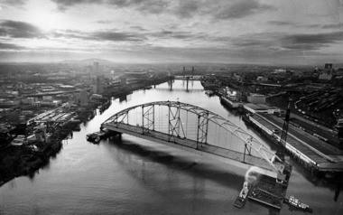David Falconer's photograph of the Fremont Bridge being completed exemplifies composition and lighting.