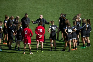 Portland Thorns coach Paul Riley addresses his team at Providence Park.