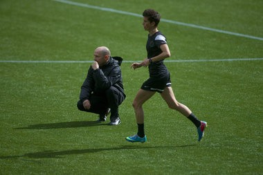 Portland Thorns coach Paul Riley watches his team run through passing drills.