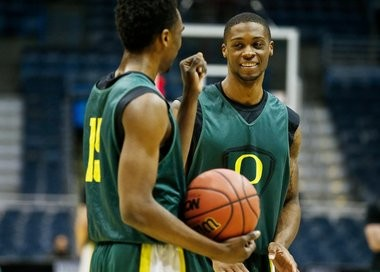Elgin Cook (right) smiles during Wednesday's shootaround at the BMO Harris Bradley Center.