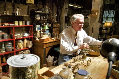 Gov. John Kitzhaber, M.D. is shown here in a file photo from September 2012 as he entertained himself on the set of an apothecary shop during the celebration of the start of filming of season 2 of the TV series Grimm.