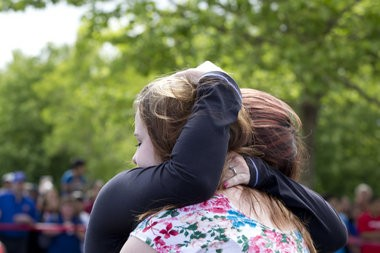 June 10, 2014 - Parents and students from Reynolds High School reunite in the parking lot at Fred Meyer. Beth Nakamura/ The Oregonian
