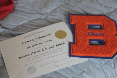 """Benson staff awarded Anderson an honorary degree. The alumni association chipped in a B with """"alum"""" stitched across it."""